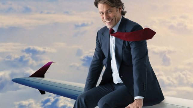 John Bishop on a plane wing